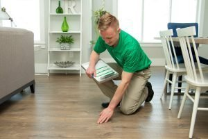 Technician assessing the damage of wood floor