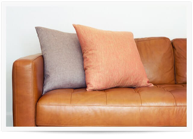 leather couch with colored pillows