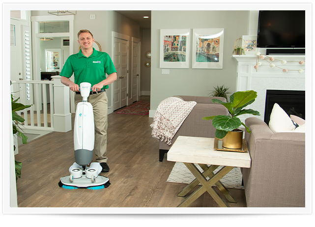 chem-dry tech performing wood floor cleaning in lafayette