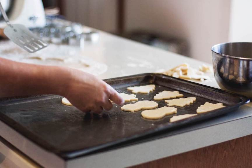 person making cookies in clean kitchen