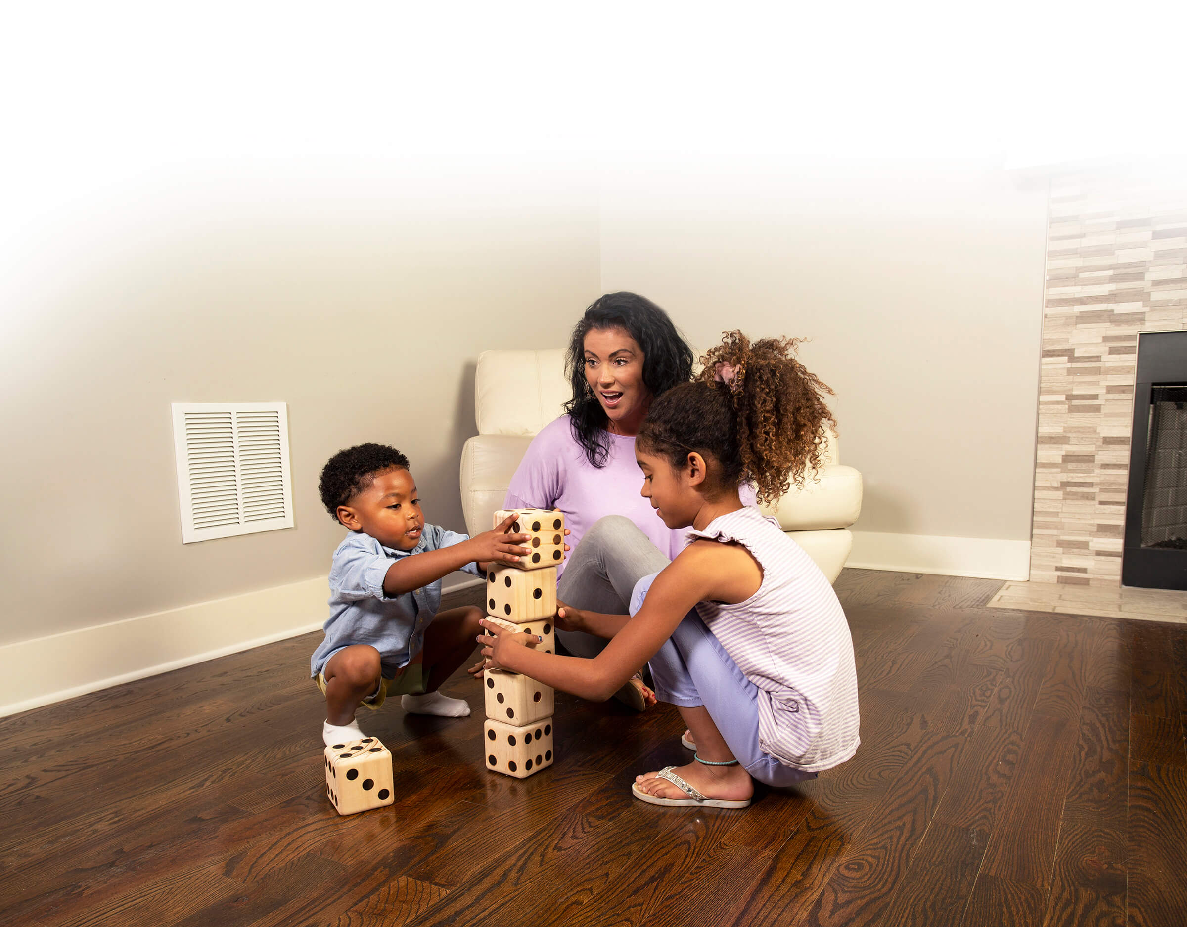 family playing on clean wood floor in lafayette home